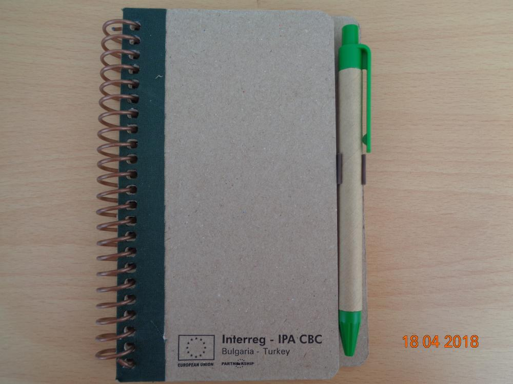 Project notepad with pens of recycled materials