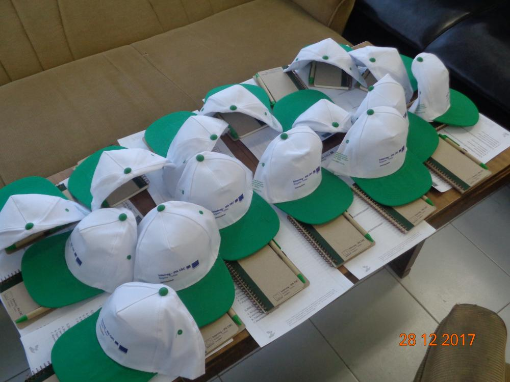 Project hats and notepads with pens
